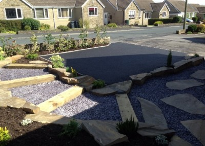 Small rockery & parking space